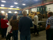 County College participants get a behind the scenes tour of the road department.